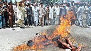 MUSLIMS BURNING CHRISTIANS